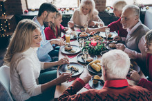 Photo Of Full Family Gathering Sitting Around Dinner Table Communicating X-mas Party Tradition All Together Son Daughter Grandma Grandpa In Noel Decorated Living Room Indoors