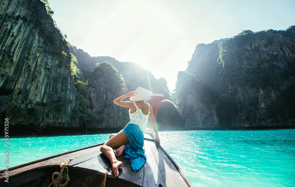 Fototapeta Beautiful woman making an excursion to phi phi island and maya beach in Thailand