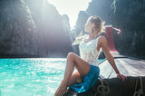 Beautiful woman making an excursion to phi phi island and maya beach in Thailand