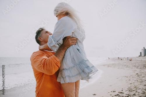 Fototapeta  Happy senior couple spending time at the beach