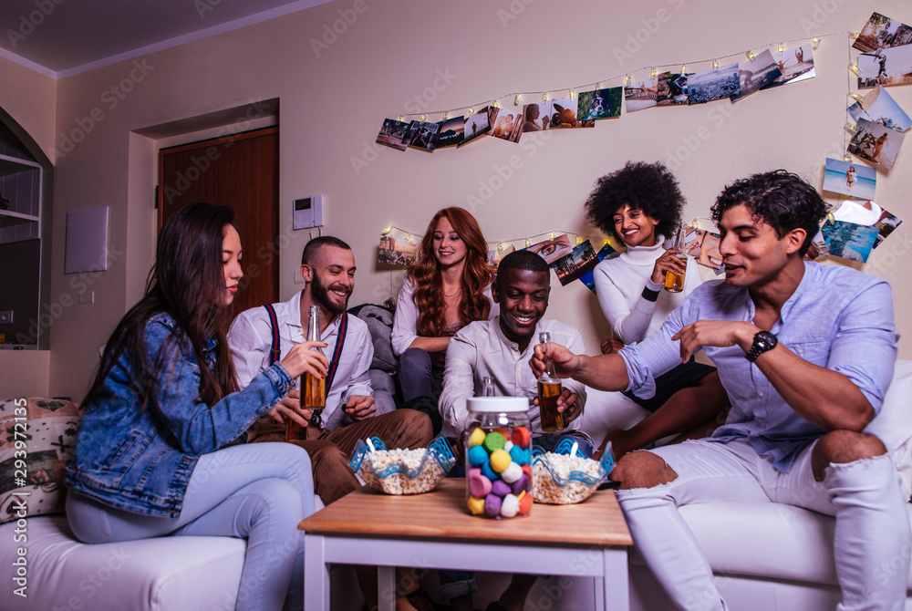 Fototapety, obrazy: A group of young people celebrating and making party at home