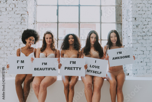 Group of women with different body and ethnicity posing together to show the woman power and strength Fototapeta