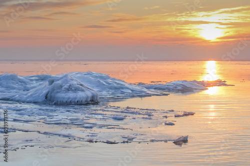 Fotografie, Obraz  Ridges on the frozen Baltic sea in dramatic sunset in wintertime