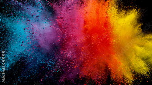 Obraz na plátně Explosion of colored powder on black background