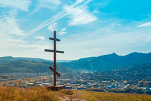 Orthodox Wooden Cross Symbol Of Faith Hill Against The Blue Sky. Pilgrimage To Holy Places. Russia. Siberia.