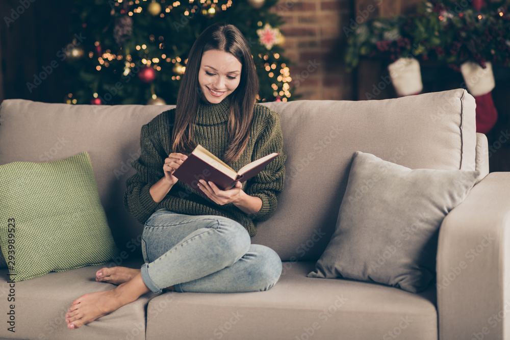 Fototapety, obrazy: Full size photo of positive cheerful woman lying on divan want her christmas celebration spend reading interesting book about love story newyear advent in house full of x-mas ornament indoors