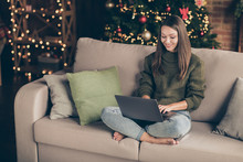 Top Above High Angle View Photo Of Positive Girl Wear Knitted Jumper Use Laptop Search Winter Shopping Discounts Text Sit Divan Cross Legs In House Full Of Christmas Decoration Illumination Indoors