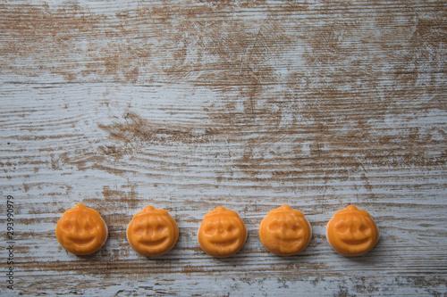 Valokuva  Halloween pumpkins on wooden surface