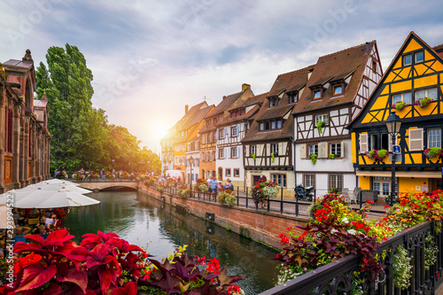 Obraz Colmar, Alsace, France. Petite Venice, water canal and traditional half timbered houses. Colmar is a charming town in Alsace, France. Beautiful view of colorful romantic city Colmar, France, Alsace. - fototapety do salonu