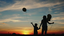 Silhouette Two Children With B...