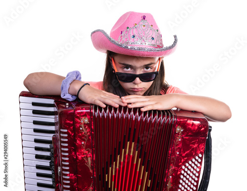 Vászonkép  Stylish young preteen girl with accordion isolated on a white background