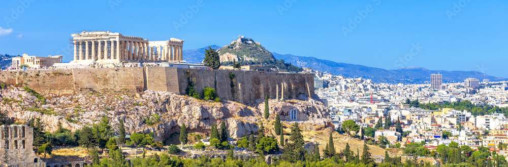 Fototapeta Panoramic view of Athens, Greece. Famous Acropolis hill rises above cityscape. It is top landmark of Athens. Landscape of old Athens city with Ancient Greek ruins. Skyline of Athens in summer.