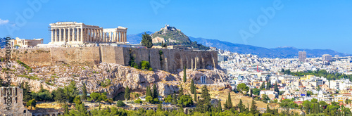 Panoramic view of Athens, Greece. Acropolis hill rises above cityscape. Landscape of old Athens city with Ancient Greek ruins. Skyline of Athens in summer.