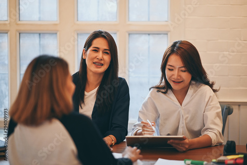 Woman together tutoring in campus university room with young woman and 30s woman with education concept Poster Mural XXL