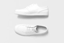 Top And Side View Of White Plain Women Men Casual Shoes On Isolated Background.