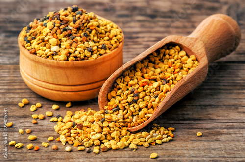 Fotografering healthy bee pollen on wooden background