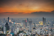 Aerial Skyline Of Bangkok Cityscape From Mahanakhon Skywalk And Business Urban Downtown With Beautiful Twilight Peak At Sunset, Cityscape Capital And Financial District Center Of Bangkok, Thailand.