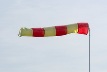 Wind Direction And Speed. Windsock On The Background Of Sky.