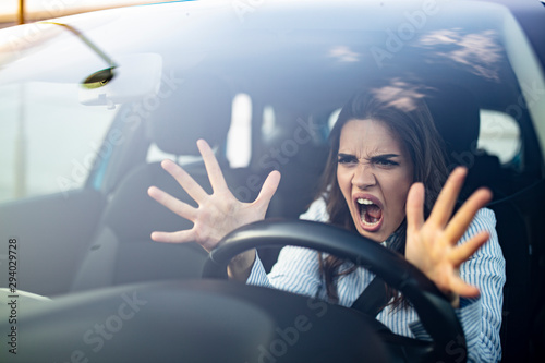 Canvastavla Window portrait displeased stressed angry pissed off woman driving car annoyed by heavy traffic isolated street background