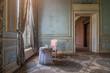 Leinwandbild Motiv Chaise rose avec une table dans un vieux château style baroque