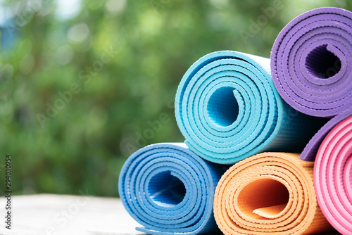Obraz close up of colorful yoga mat on the table, sport and healthy concept - fototapety do salonu