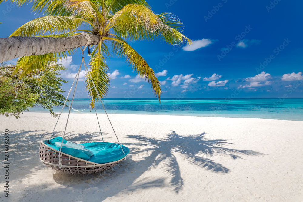 Fototapeta Summer beach background as summer landscape with beach swing or hammock and white sand and calm sea for beach banner. Perfect beach scene vacation and summer holiday concept. Boost up color process