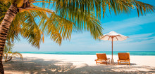 Beautiful Maldives Island Beach Landscape. Luxury Resort With Chairs And Umbrella For Summer Vacation And Holiday Background. Exotic Tropical Beach Concept
