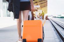 Woman Tourist With Orange Suit...
