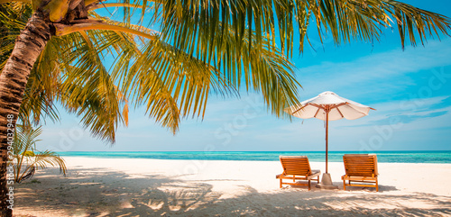 Tuinposter Palm boom Beautiful Maldives island beach landscape. Luxury resort with chairs and umbrella for summer vacation and holiday background. Exotic tropical beach concept