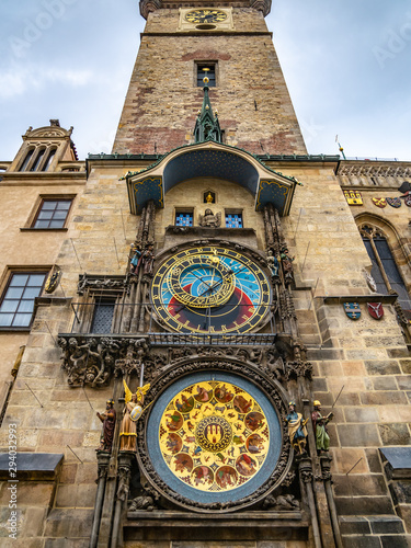 Obraz Astronomical Clock Orloj closeup in Czech Republic, Europe. Vintage style. Prague clock tower detail. Famous attraction residents of Praga - fototapety do salonu