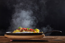 Steaming Hot Sizzler On Wood
