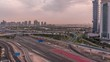 Aerial top view to Sheikh Zayed road near Dubai Marina and JLT skyscrapers morning timelapse, Dubai. Traffic, bridges and metro line. Cloudy sky after sunset. United Arab Emirates