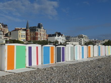 Colorful Beach Huts On The Bea...