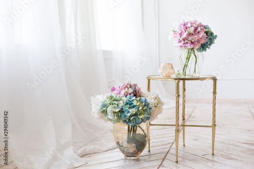 Fotobehang Bloemenwinkel bouquet of artificial hydrangea on a mirror table