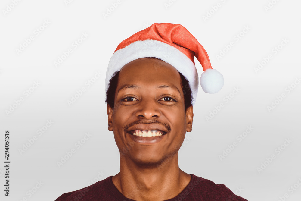 Fototapeta happy man in christmas hat.