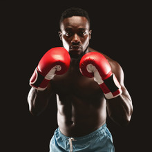 Portrait Of Confident African Boxer Standing In Ready Pose