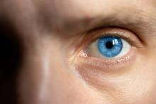 Bright Male Eyes With Blue Iri...