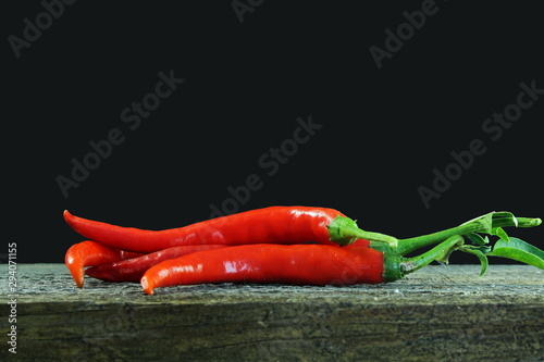 Garden Poster Hot chili peppers ripe red hot chili pepper isolated in black background