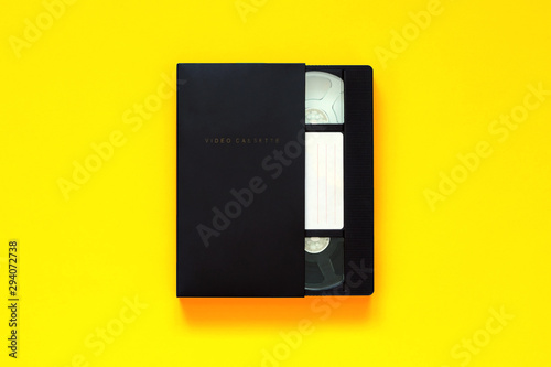 Video tape on colored background, VHS, top view Slika na platnu