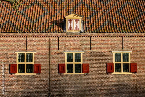 16th Century Dutch Facade with Shuttered Windows and Jolly Rooft Canvas-taulu