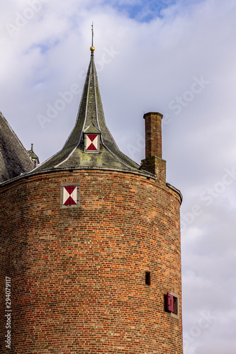 Fotografie, Obraz Medieval Castle Tower with Tiny Shuttered Window