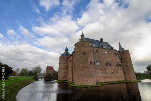 Medieval European Brick Castle with Large Moat and Later Renovations Wallpaper Mural