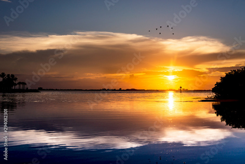 Sunset sky at the beach, flock of birds, beautiful landscape