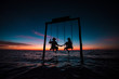 Leinwandbild Motiv Couple contemplating an amazing sunset at Holbox Island in the Caribbean Ocean of Mexico
