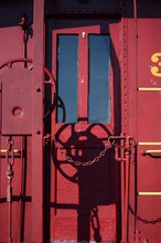 Red Caboose Door With A Chain Over The Opeing
