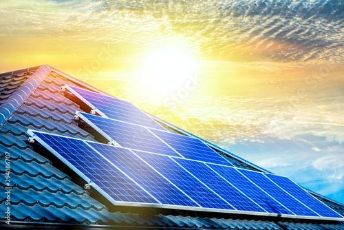 Obraz Solar panels on the roof of a building . Solar cells for solar energy . apartment house - fototapety do salonu