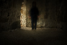 Spooky Tunnel Or Basement With Dark Blurred Ghost In Dimmed Light
