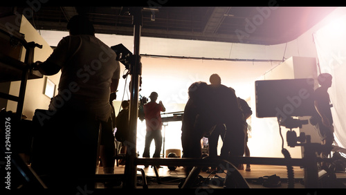 Silhoutte images of video production and lighting set for filming which movie crew team working and silhouette shadow of camera and professional equipment in big studio for commercial advertising Canvas Print