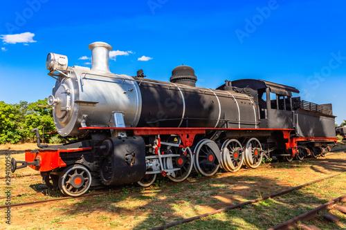 Fototapeta Old retro preserved locomotive train standing on the rails in Livingstone, Zambi