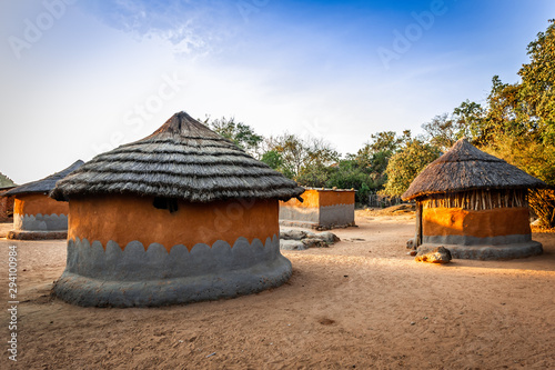 Local village with traditional zimbabwian huts from clay and hay Canvas Print
